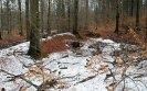 Výrazná protržená hráz, rovněž přímo na potoce, nejvýše položený prvek kaskády